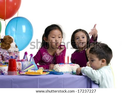 A small group of kids celebrating a birthday.