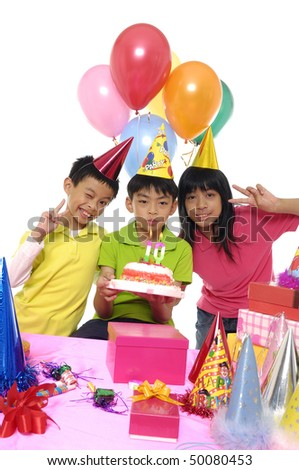 A small group of kids celebrating a birthday. - stock photo