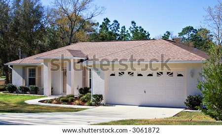 A small home in Florida owned by retired senior. - stock photo