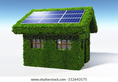 a small house covered by grass on the walls and on the roof, has some solar panels placed on one side of the roof with the sun that reflects in them, on a white background and a blue sky - stock photo