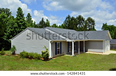 A small house with vinyl siding. - stock photo