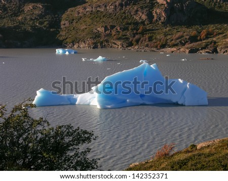 A small iceberg in Lago Grey in the Torres del Paine national Park, Patagonia, Chile. A rare view on a calm morning. - stock photo