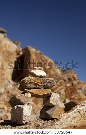 A small Inukshuk on the top of the mountain of whistler - stock photo