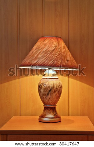 a small lamp on the nightstand - stock photo