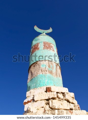 A small local mosque under blue sky in the desert of Hurghada, Egypt. - stock photo