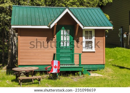 A small log cabin for enjoying time at the lake. - stock photo