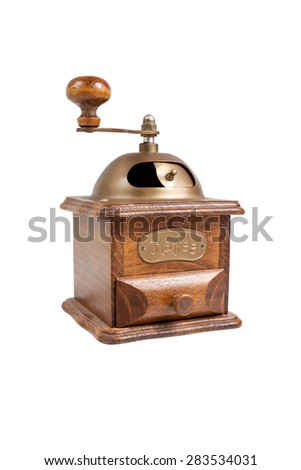A small machine for grinding roasted coffee beans, on white background.