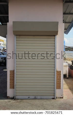 Small Metal Rolling Garage Door Stock Photo Royalty Free 701825671