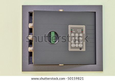 a small open safe in an apartment - stock photo