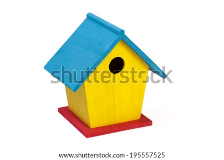A small painted wooden birdhouse isolated on a white background - stock photo