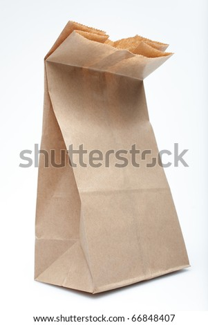 "A small paper sack. Photographed with studio light in front of a white background, but not ""cut out"" with software. - stock photo"