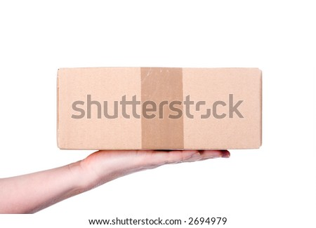 A small parcel, presented on a human hand from the left side. Isolated on white. - stock photo