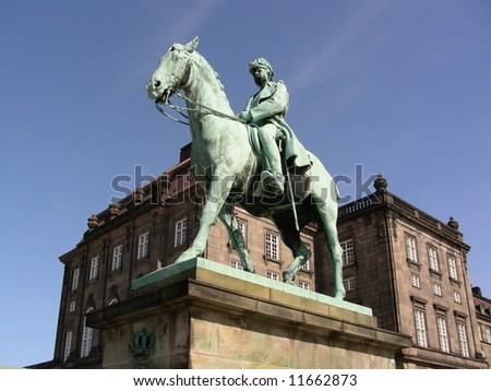 A small part of Christiansborg where the goverment are placed and a statue of King Christian the IX