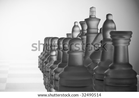 A small pawn with large other chess-pieces - stock photo