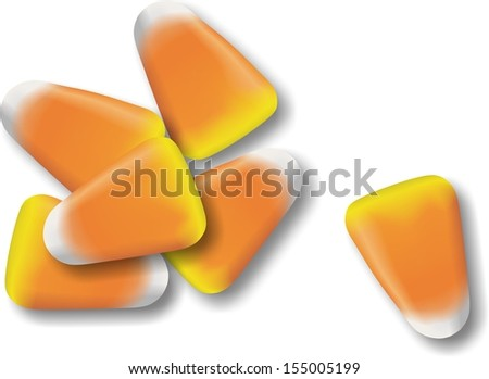 A small pile if candy corn usually sold and handed out during Halloween. - stock photo