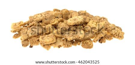 A small pile of broken chocolate chip animal crackers on a white background.