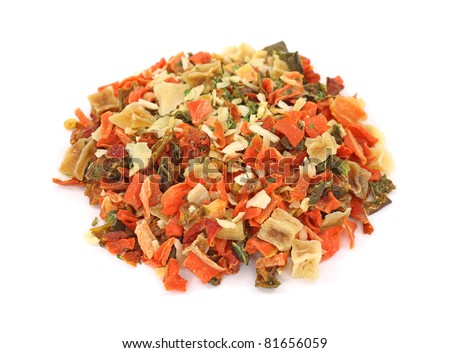 A small pile of dehydrated vegetables used for seasoning on a white background. - stock photo