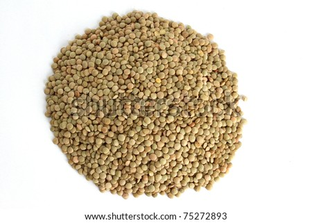 A small pile of lentil beans on white background