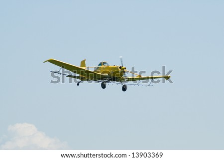 A small plane high in the sky in the middle of flight