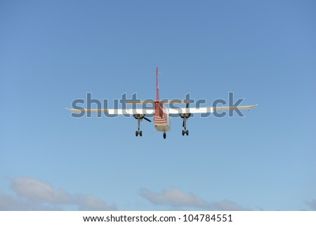 A small plane on approach - stock photo