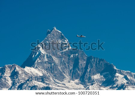 a small plane passing by the famous snow mountain, Fishtail, in Nepal