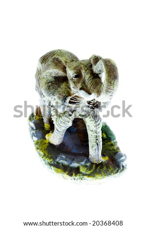a small plastic toy elephant isolated on the white background - stock photo