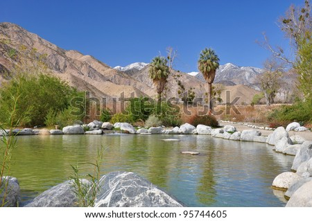 A small pond sits in the foreground of snow-capped Mount San Gorgonio at the Whitewater Canyon Preserve in Southern California.