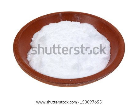 A small portion of baking soda in a red clay bowl on a white background. - stock photo