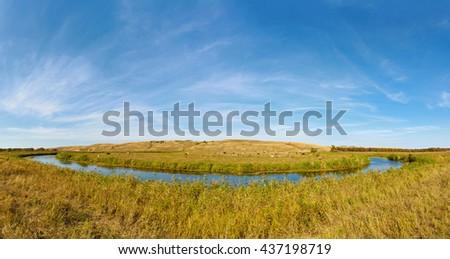 A small prairie river Big Melik. Cows graze on the banks. Saratov region, Russia. - stock photo
