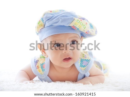 A small pretty child lying on a surface - stock photo