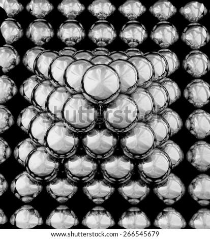 a small pyramid of metal mirror balls - stock photo
