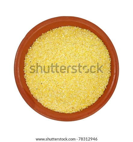 A small red clay dish filled with polenta on a white background.