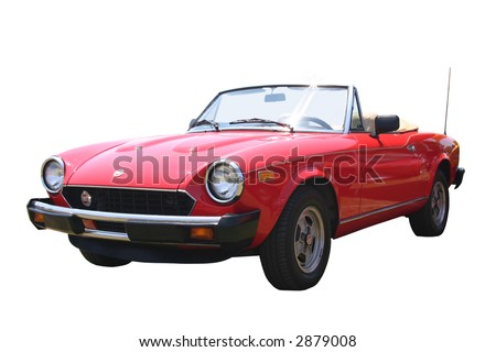 a small 1980s red Italian Fiat Spider convertible, with the top down, that has been isolated on white.