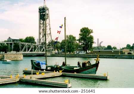 A small sailboat in Canadian harbor - sail-show - stock photo