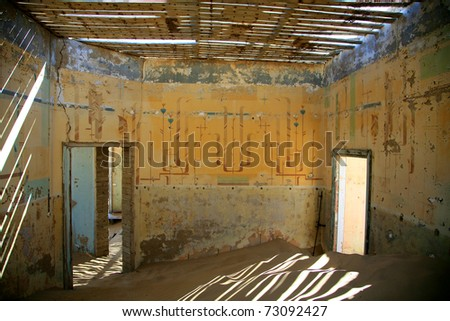 A small sand dune formed in an old derelict house in Kolmanskop, Namibia - stock photo