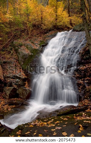 A small secluded waterfall in the forests of West Virginia. I like this type of waterfall with its many ledges for the water to tumble across. Taken with a slow shutter speed to smooth the water. - stock photo