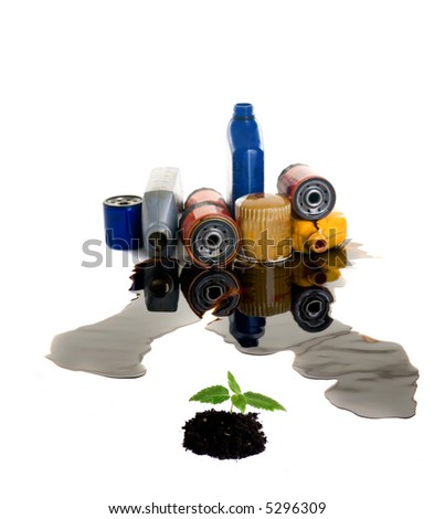 A small seedling is surrounded by the pollutants that we pour onto our earth. Where is your oil going? - stock photo
