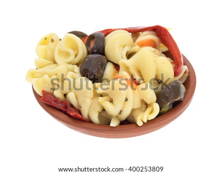 A small serving of rotini pasta salad in a small bowl isolated on a white background. - stock photo
