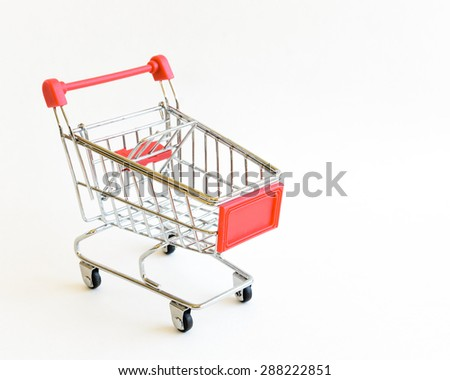 A small shopping cart isolated on white background. Concept for online shopping and e-commerce. Copy space. - stock photo