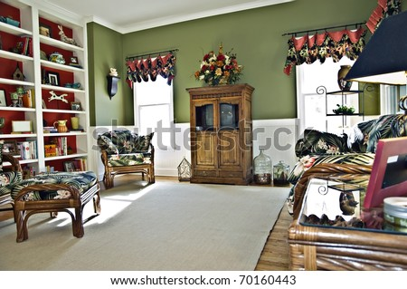 A small sitting area off the kitchen that is call a keeping room. It could be a den or family room, also. - stock photo