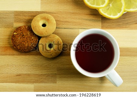 a small snack composed of biscuits and tea