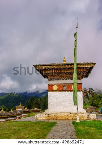 A small stupa or pagoda in the Druk Wangyal Chortens, Bhutan in a blur background of forest and mountains on September 20 2016