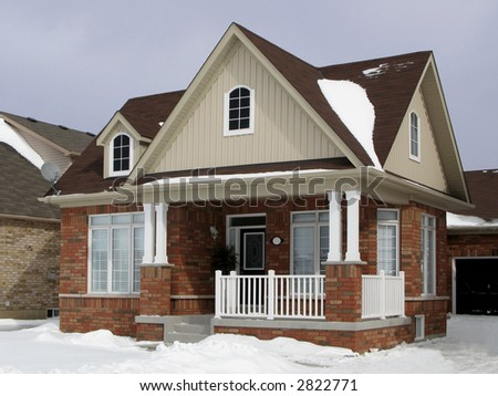 A small suburban house in winter. - stock photo