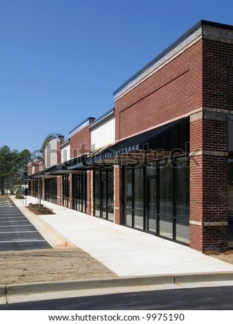 A small suburban shopping center in the final stages of construction.