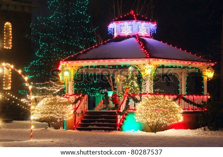 A small-town Christmas display centered around the village gazebo - stock photo