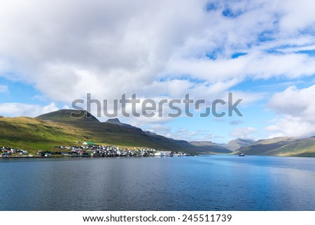 A small village on one of the Faroe Islands. Sunny. - stock photo