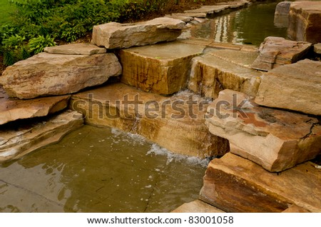 A Small Waterfall in a creek with Brown Rocks - stock photo