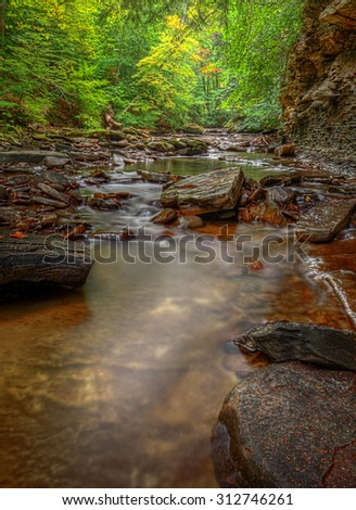 A small waterfall on Brandywine Creek in Cuyahoga Valley National Park Ohio.  Seen here in summer with low water flow. - stock photo