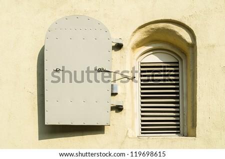 A small window at stony wall of of ancient fortress, Riga, Latvia - stock photo