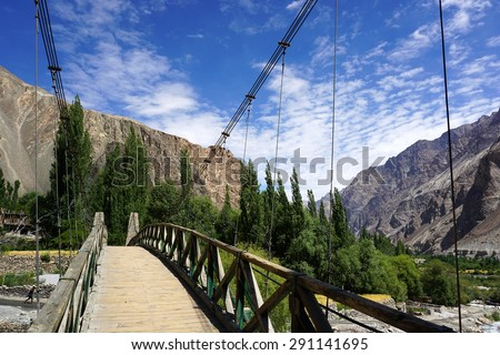 A small wooden bridge with nature in Nubra Valley in Turtuk, Leh Ladakh. Turtuk is a village 205 km from Leh on the banks of Shyok River near Pakistan